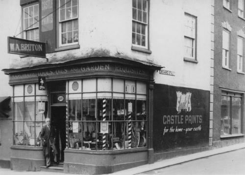 W A Bruton outside his shop, 18 Long Street